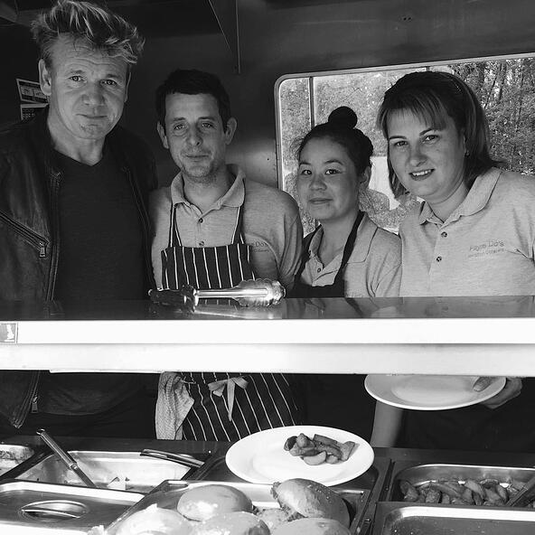 Gordon Ramsay joins Jamie Cook and Fayre Do's in the food truck on set.
