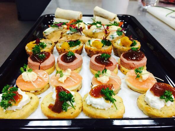 Delicious canapes being served on set by Fayre Do's catering.