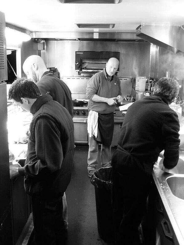 Jamie Cook with the Fayre Do's catering staff preparing meals in the food truck.